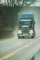 Truck driving in rain