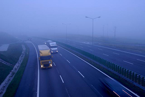 Truck driving in fog